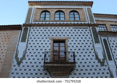 Balcony railing and arch windows in a decorated facade