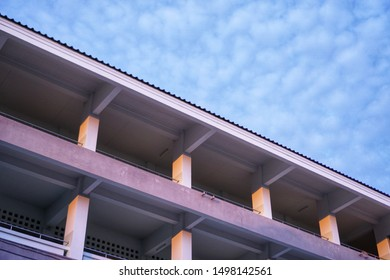 The balcony of a school building and the beautiful sky with many small clouds like a cotton ball.