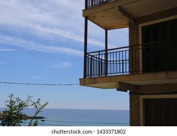 Balcony suspended at the seaside with blue sky.