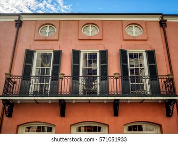 Balcony with three doors and windows in Then French Quarter of New Orleans LA USA.  Many interesting doors and balconies are located in the Quarter.