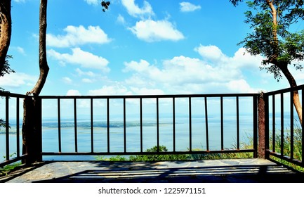 Balcony view of lake with skyscape in sunny day.