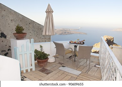 Balcony view at the Santorini and breakfast table near the sea