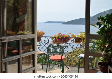 Balcony with a view to a sea and coast in summer