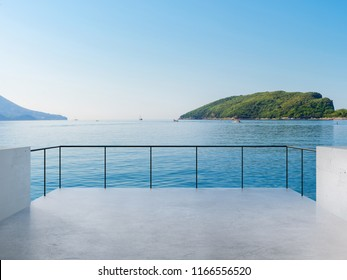 Balcony View Of Sea And Mountains Landscape During Sunny Day