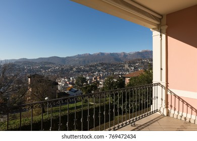 Balcony of vintage villa and panorama over Lugano lake