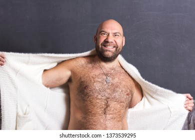 Bald brutal man in white fur coat.