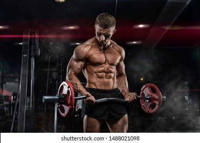 bald brutal sexy strong bodybuilder athletic fitness man pumping up abs muscles workout bodybuilding concept background