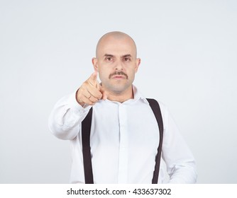 Bald businessman pointing at the camera with. Isolated on background.