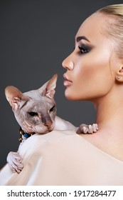bald cat with Beautiful girl. beauty make-up young woman. Friendship