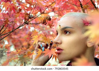 Bald Caucasian girl with audacity standing in front of pink tree in spring