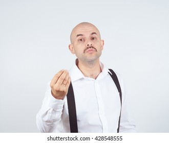 Bald funny man sends a air kiss to the camera.