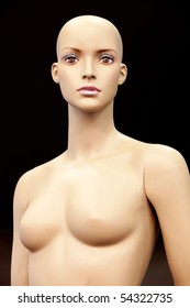 Bald girl mannequin isolated on black background
