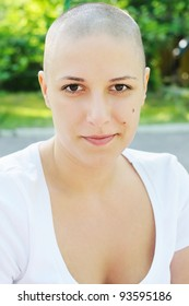 Bald girl, outdoors portrait