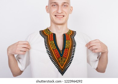 023477d03f7 bald guy in the national African costume-dashiki. emotional portrait of a  student.