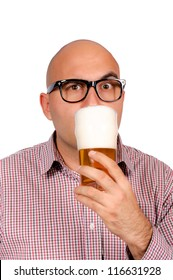 Bald man drinking the glass of beer