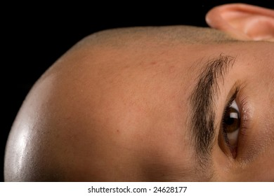 Bald man head on side, with focus on eye