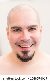 Bald man portrait with goatee