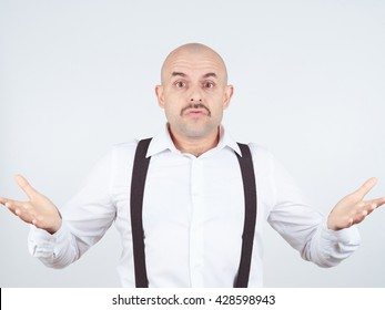 bald man shrugging shoulders I don't know gesture Isolated.  Human body language.