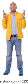 Bald man in yellow jacket hopes for the best final results. He is gesturing with both hands. Full length cutout photo. Isolated on white background.