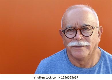 Bald senior man looking at camera