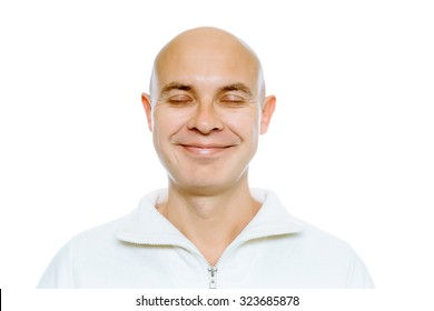 Bald smiling man with his eyes closed. Isolated on white. Studio