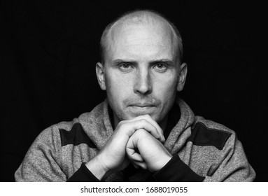 Bald young man looking and portrait in bw