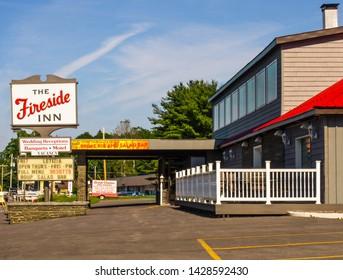 Baldwinsville, New York, USA. June 19, 2019. The Fireside Inn, a local landmark restaurant and event establishment across from the Seneca River in the small town of Baldwinsville, NY