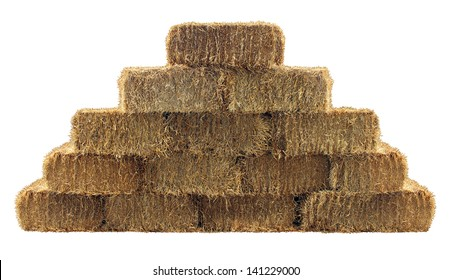 Bale of hay group in a pyramid wall pattern isolated on a white background as a country  design element and agriculture farm and farming icon of harvest time with straw as bundled tied haystacks.