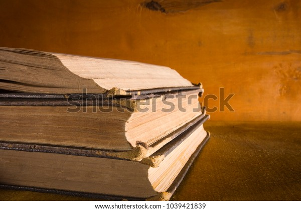 Bale of old books on a wooden background