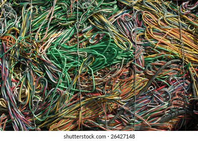 A bale of recycling communication cables. There is a mix of plastic and copper to recover.