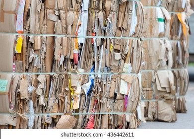 Bales of cardboard and box board with strapping wire ties