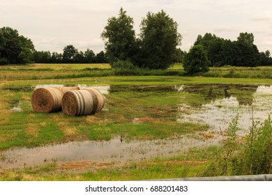 Bales of straw on a flooded meadow