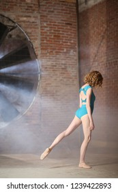 Balet dancing in a blue swimsuit