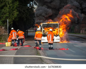 BALGE, GERMANY - DECEMBER 16, 2013: Firefighters extinguish a burning bus  on December 16, 2013 in Sebbenhausen, community Balge, Germany
