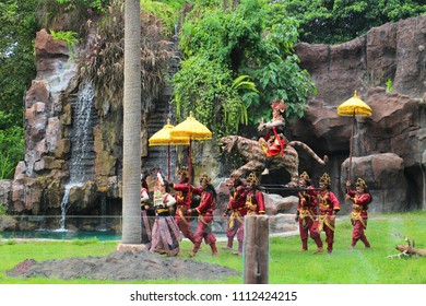 BALI 2017 - People performing balinese dancing by wearing colorful traditional clothes in Bali Safari Marine Park Zoo during January holiday