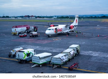 Bali, 22 May 2019 : Twin Engine ATR 72 Turboprop Aircraft from Wing Airlines Being Fuel by Pertamina Tanker Truck at Ngurah Rai International Airport in Denpasar.