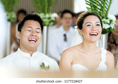 Bali 6 June 2012 - Marriage couple are so happy while having their holy wedding blessing ceremony in a church