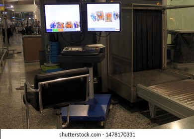 BALI - AUG 08 2019:Baggage screening monitoring at Ngurah Rai International Airport Bali Indonesia.Airport security attempts to prevent threats and dangerous situations entering the country.