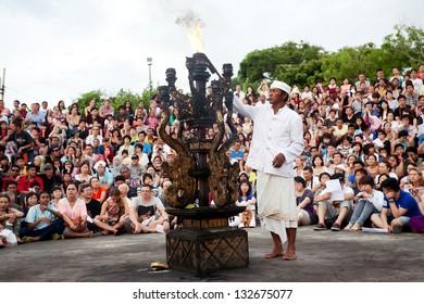 BALI - DECEMBER 30: man lights a fire before traditional Balinese Kecak dance at Uluwatu Temple  on Dec 30, 2012, Bali, Indonesia