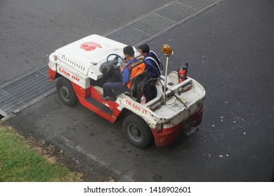 BALI, DENPASAR / INDONESIA - MAY 17 2019: Ground Handling Workers Driving the Push Back Car at the Airport