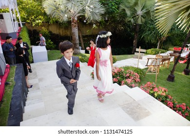 BALI FEBRUARY 2011 - Two adorable kids are walking to the chapel for celebrating their uncle's wedding in such beautiful day in Bali Indonesia