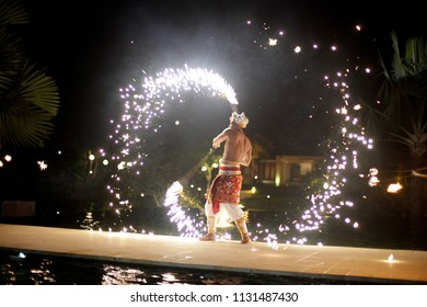 BALI FEBRUARY 2014 - Balinese dancer is performing fire dance in wedding celebration party during summer season in Bali Indonesia