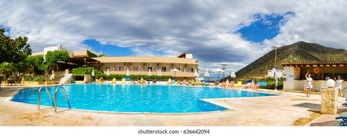 Bali, Greece - May 2, 2016: Animation at Resort hotel Atali Village 4 star. Cute girls in white beach suit girls dancing in front of swimming pool with clean blue water for tourists. Crete island