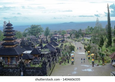 Bali, Indonesia - 08 March 2018: Pura Agung Besakih temple by blue sky. Summer landscape with religious building pura basuki puseh jagat and walking people