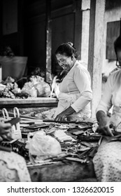 Bali / Indonesia - 09 2019: lady worker smiling despite the circumstances.