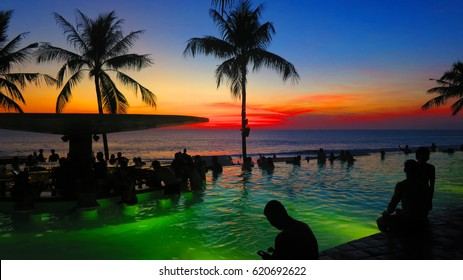 Bali, Indonesia - 10 October, 2016: Vibrant and colourful view of island beach sunset and swimming pool bar from the tourist popular Potato Head Beach Club. 10/10/2016.