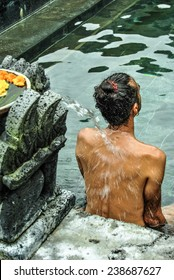 BALI, INDONESIA - 13 APRIL 2013: Man from the back is relaxing in the hot springs outdoors.
