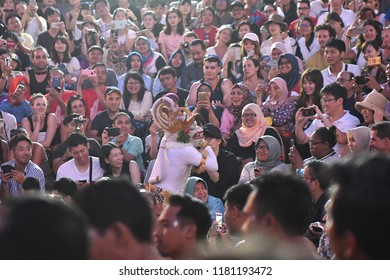 Bali, Indonesia – 13 Sept 2018: Tourists watch traditional Balinese Kecak Dance at Uluwatu Temple on Bali, Indonesia. Kecak (also known as Ramayana Monkey Chant) is very popular cultural show on Bali.