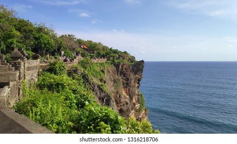 BALI, INDONESIA- 14 FEB, 2019: Cliff at Uluwatu Temple or Pura Luhur Uluwatu. One of tourist attraction in Bali Indonesia.
