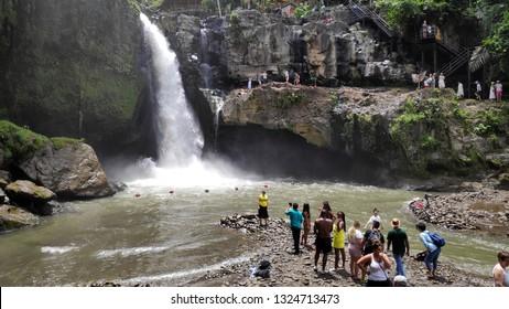 BALI, INDONESIA- 14 FEB, 2019: Tourists visit Tegenungan Waterfall near Ubud in Bali, Indonesia